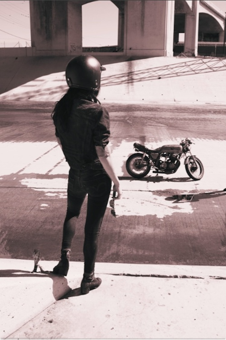 Motorcycle woman, looking longingly