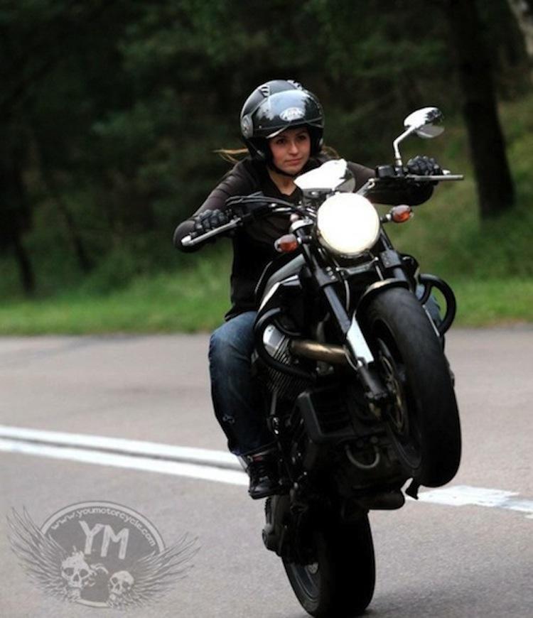 girl motorcycle wheelie