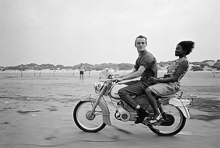 Moped riding beach,